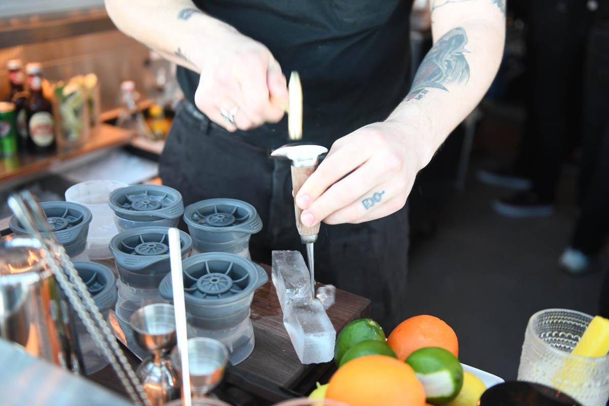 Lincoln social bartender crushing ice