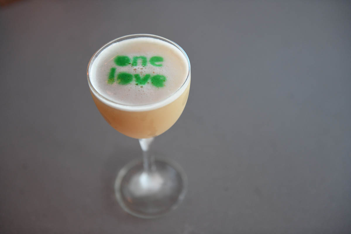 Lincoln Social specialty cocktail with theme - One Love