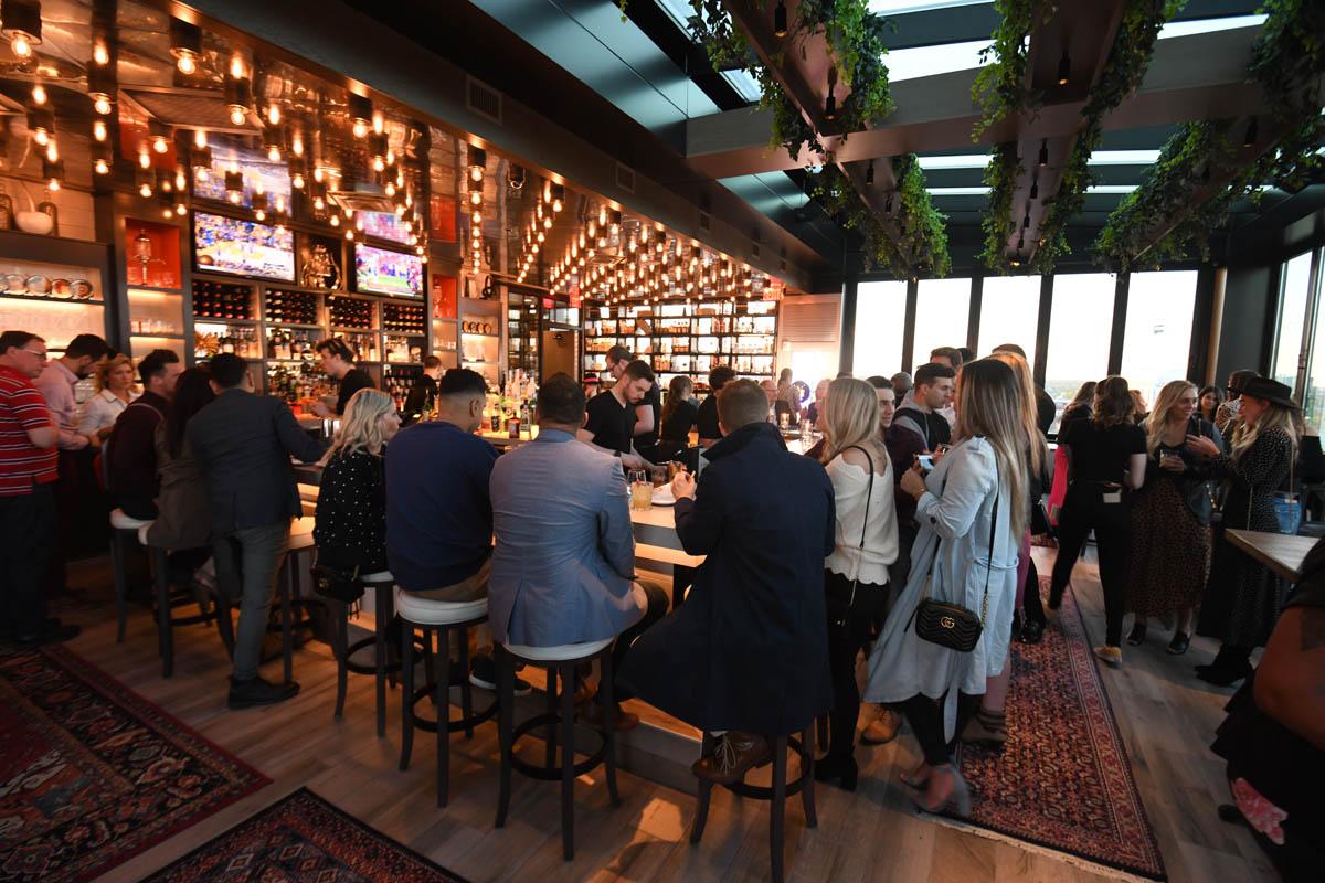 Lincoln Social guests at bar