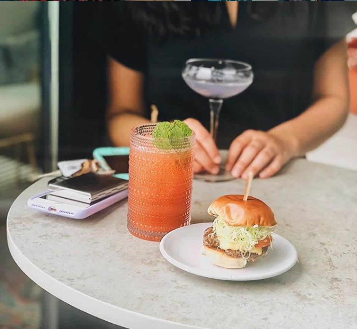 burger and drink at Lincoln Social