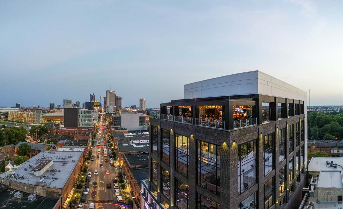 Drone view of dusk on Lincoln Social rooftop facing toward downtown Columbus