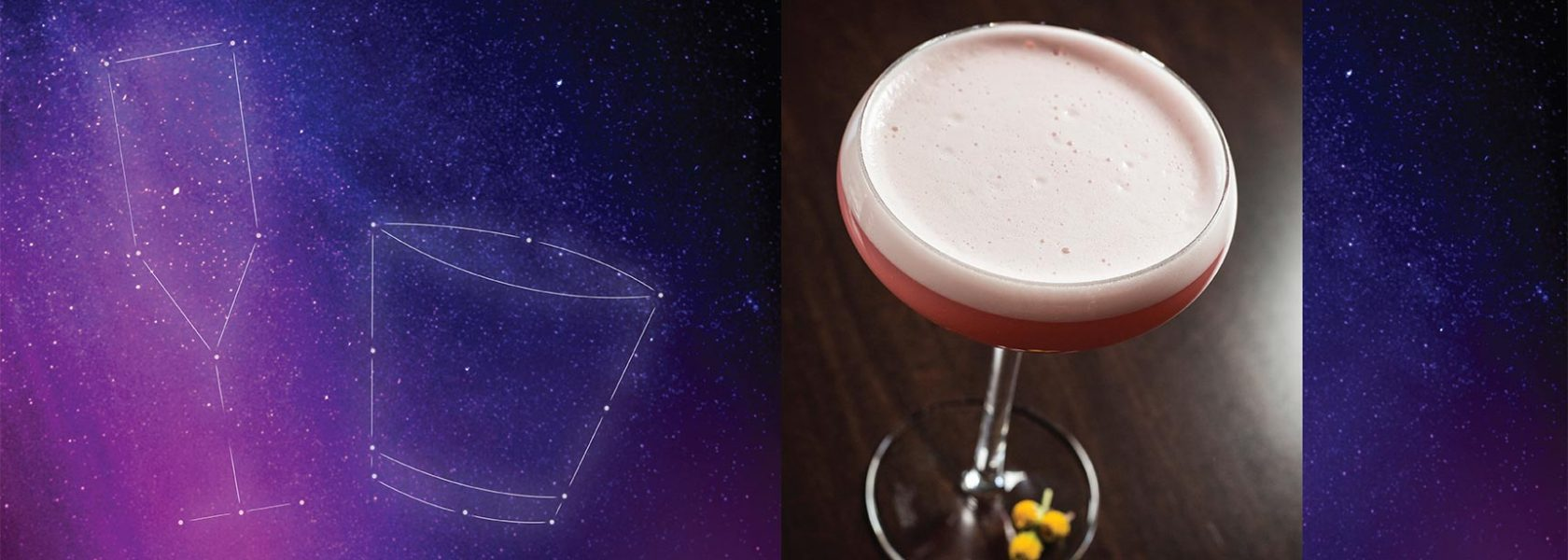 Foamy cocktail in champagne glass floating on night sky background