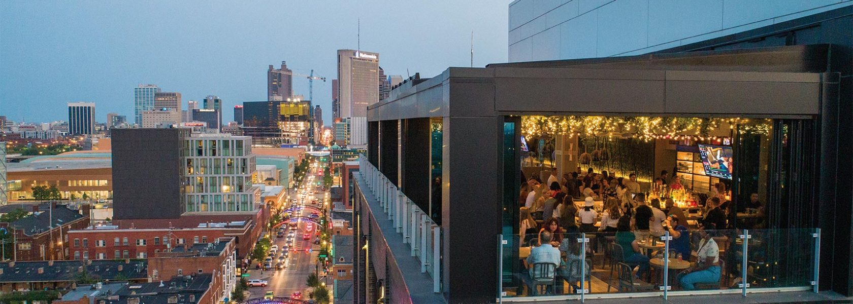 Drone view showing Lincoln Social's rooftop with guests enjoying view south on High Street toward downtown Columbus